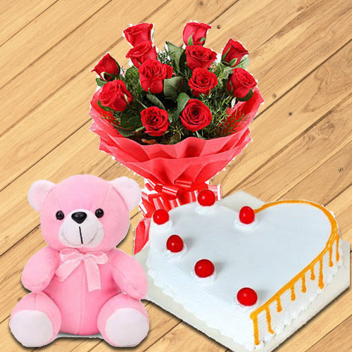 Graceful 12 Dutch Red Roses with Teddy Bear and 1/2 Kg Heart Shaped Cake