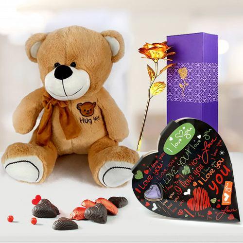 Resplendent Valentine Gift of Hug Me Teddy with Heart Chocolate n Golden Rose