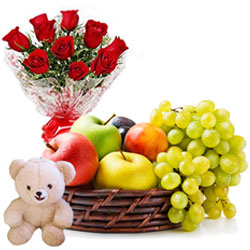 Memorable Selection of Mixed Fruits Basket with Cute Teddy and Vibrant Red Roses Arrangement
