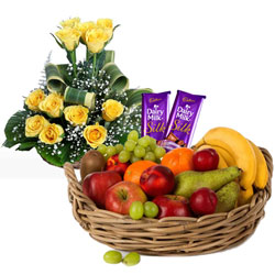 Delectable Dairy Milk Silk with Roses Arrangement and Fruits Basket