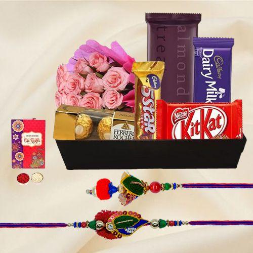 Sweet N Savory Chocolate Hamper with Pink Roses with Bhaiya Bhabhi Rakhi, Roli, Tilak and Chawal