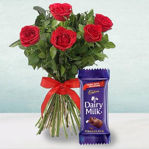 Attractive 5 Red Roses Bunch with a Cadbury Chocolate Bar