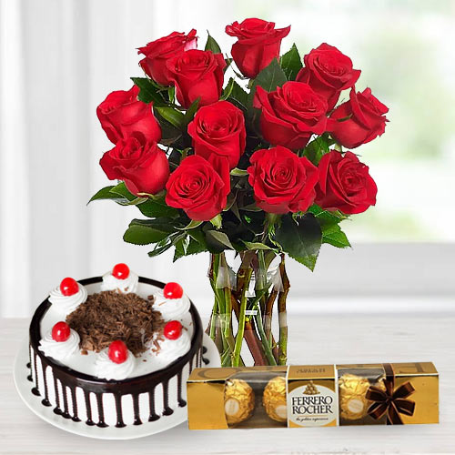 Gorgeous Bouquet of bright Red Roses, tasty Ferroro Rocher and delicious Black Forest Cake