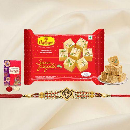 Mesmerizing Gift Set of Haldiram Soan Papri with Rakhi Roli Tika and Chawal for the Occasion of Raksha Bandhan