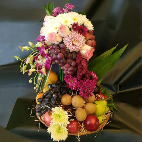 Beautiful Tall Arrangement of Flowers n Fruits