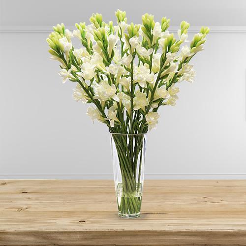 Captivating Arrangement of White Rajniganda Sticks in a Glass Vase