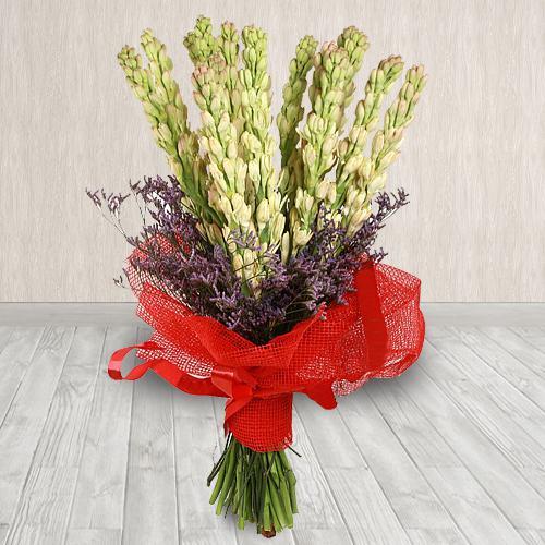 Elegant Hand-Designed Bouquet of Rajnigandha in Tissue Wrapping