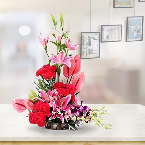 Designer Arrangement of Pink Anthurium with Cala Lilies