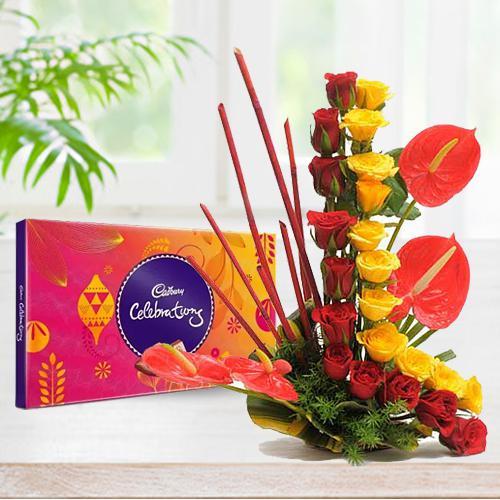 Beautiful Roses with Anthurium Arrangement with Cadbury Celebration
