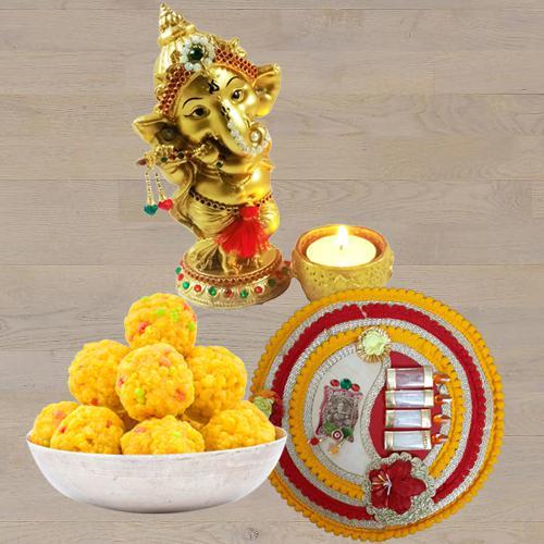 Marvelous Ganesha Idol with Boondi Ladoo N Thali<br>