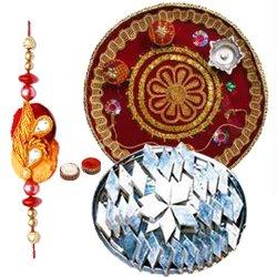 Trendsetting Selection of Haldirams Kaju Katli and Pooja Thali with Rakhi, Roli Tilak and Chawal