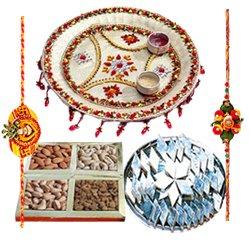 Enticing Rakhi Special Gift of Pooja Thali, Dry Fruits and Delicious Kaju Katli with 2 Free Rakhi, Roli Tika and Chawal