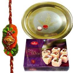 Traditional Combo Gift of Gold Plated Thali and Tasty Haldiram Soan Papri with Free Rakhi, Roli Tilak and Chawal