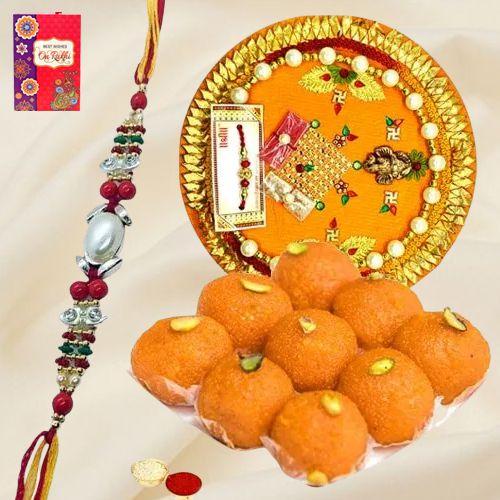 Arresting Rakhi Special Gift of Laddoo from Haldiram and Rakhi Thali along with Rakhi, Roli Tilak and Chawal
